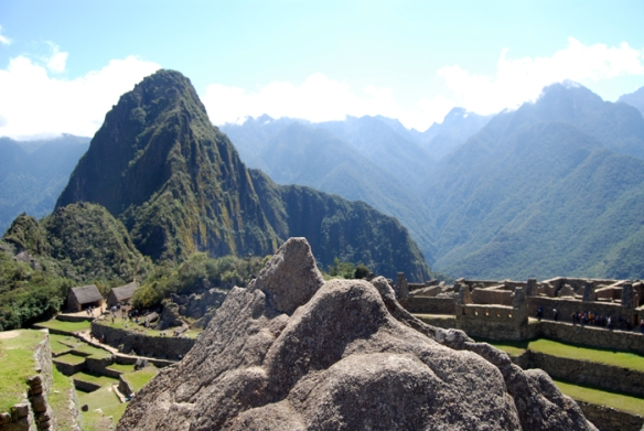 A natural rock that resembles Huayna Picchu in the background.