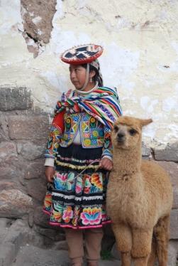 Child with alpaca