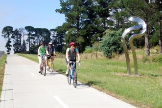 Cycling past artwork on the EastLink Trail