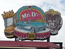 Eating a bacon cheese burger at the Route 66 Diner, USA