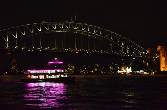 Sydney Harbour Bridge and illuminated ferry