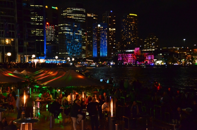 Opera House dining area and downtown lit for Vivid
