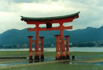 Floating torii gate at low tide