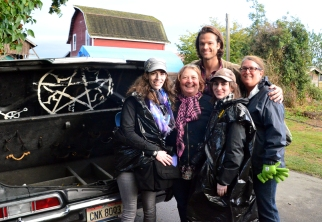 Jared Padalecki with some pretty stunned fangirls - and the impala.